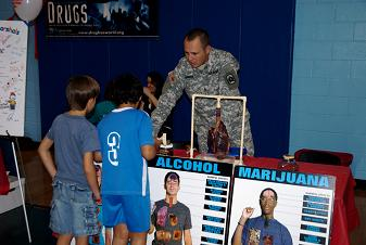 A U.S. Army solider educates children on the harmful side effects of drugs - Photo by RGP Media