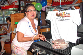 Grand Prize Winner Patricia Keicher shows off her new grill - Photo by Simaen Skolfield