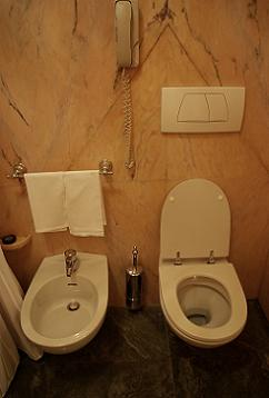 Once reserved for Europeans, bidets are now popular all over the world -­ except in North America. Pictured: A toilet and bidet in a Westin Hotel in Italy - Photo by Brandi Sims, Courtesy of Flickr