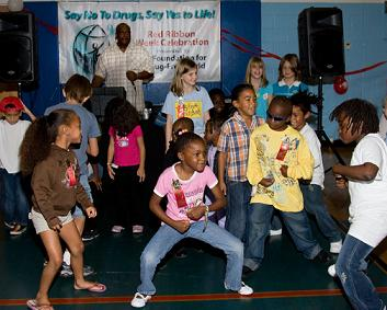 Youth at the Foundation for a Drug-Free World Red Ribbon Week Celebration event at the North Greenwood Recreation & Aquatics Center show off their moves during the dance contest