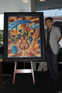 Artist John Brennan with the Clearwater Jazz Holiday 2009 Poster