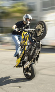 A biker performs a near-vertical wheelie - Photo by Simaen Skolfield