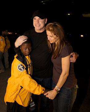 John Travolta and Kelly Preston with a Hatian orphan - Photo by Brad Kugler