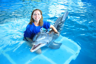 Winter the Dolphin with a CMA Volunteer