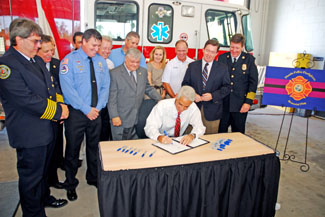 Governor Charlie Crist Signs a Bill at the Firefighter Memorial Flag Bill Signing Ceremony at the City of Oldsmar Fire and Rescue