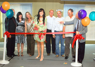 Joy Gendusa Cuts the Ribbon on her New PostcardMania Building