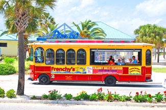 The Jolley Trolley does its rounds on Clearwater Beach.