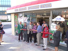 Clearwater's City Councilmen and Chamber of Commerce staff cut ribbon with store manager. (left to right) George Mesmer, Doug Linder, George Cretekos, Shelley Jaffe, Paul Gibson, John Doran, Kathleen Peters and Chuck Warrington (of Clearwater Gas). Photo by Ian Phoenix.