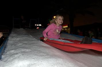 Miracle on Cleveland Street Featured 40 Tons of Snow and a Snow Slide for Kids to Play On - Photo by Chris Connell