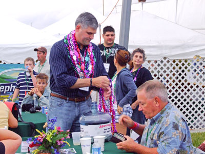 Mayor Frank Hibbard gets involved and sells beads to Keep Jazz Free - Photo by Simaen Skolfield