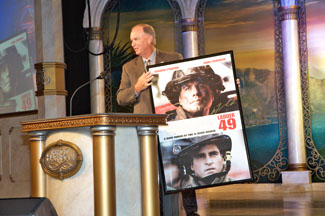 Rep. Hooper receives an autographed poster of Ladder 49 as a thank you for his service to his community - Photo by David Ziff
