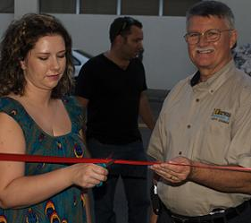 Dawn Shannon cuts the ribbon on her new salon location with the help of her stylists and Councilman John Doran - Photo by RGP Media