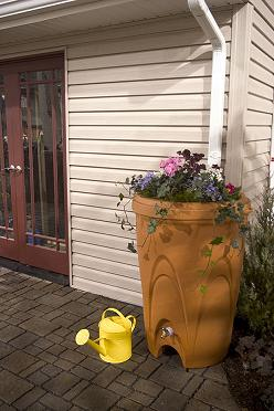 Collecting rain water from your gutters' downspouts is a no-brainer and is not expensive to do. It can then be used to water the lawn and garden, and even be used for laundry, dishes and other interior needs with the addition of a water purification system - Photo from RainXchange