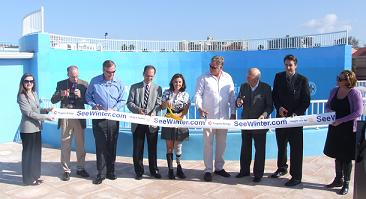 The ribbon was cut on Winter and Panama's New Home - Photo by Heidi Lux