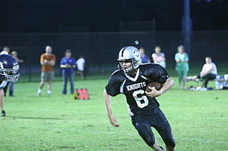 Clearwater Knights football player Ralph Schwyter goes for the touchdown - Photo by Scott Chinchar
