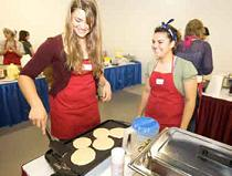 Eva and Tawny making pancakes at the Say No to Drugs Finish Line. Photo by Brad Kugler