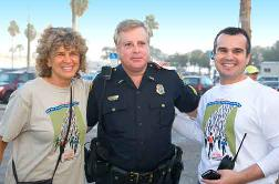 Say No to Drugs Race Directors Sue Minkoff and Chris Alexander with Sgt. Breest of the Clearwater Police. Photo by Brad Kugler